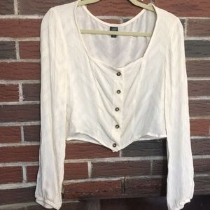 NWOT Wild Fable cream colored crop top, size M.